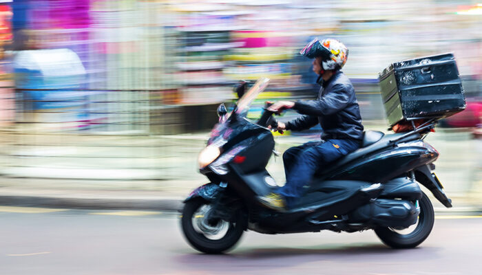 Courier delivering goods by scooter with optimal order routing