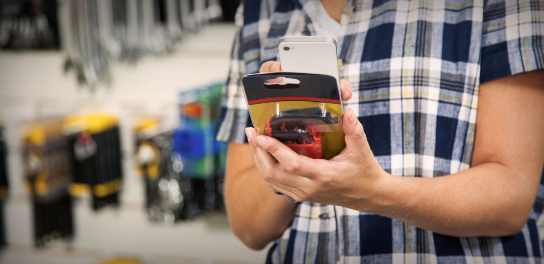Personal shopper scans an item with a mobile phone