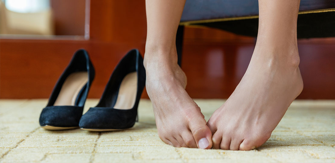 women trying on shoes